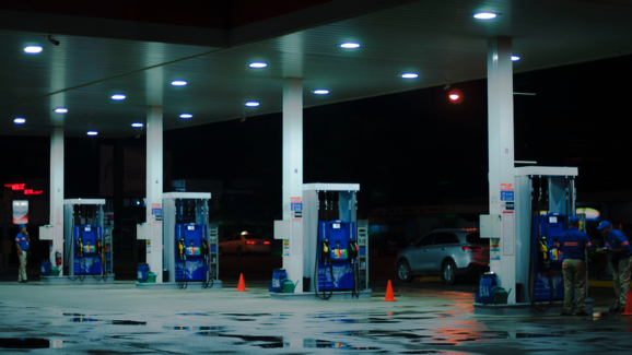 A gas station at night showing different pumps
