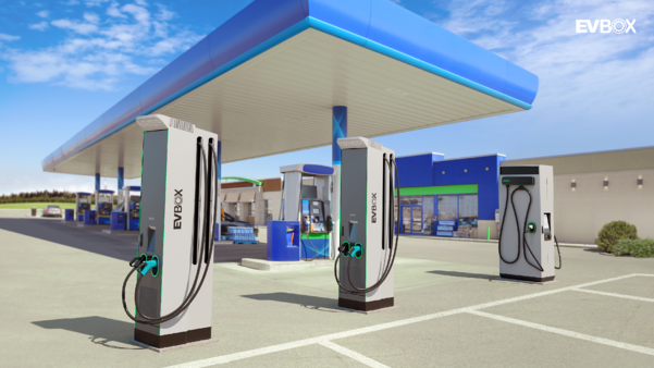 Modern looking gas station with EVBox DC fast charging stations in the parking lot.