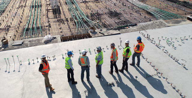 Construction workers on a roof