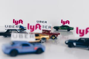 Cars labeled with Lyft and Uber signs