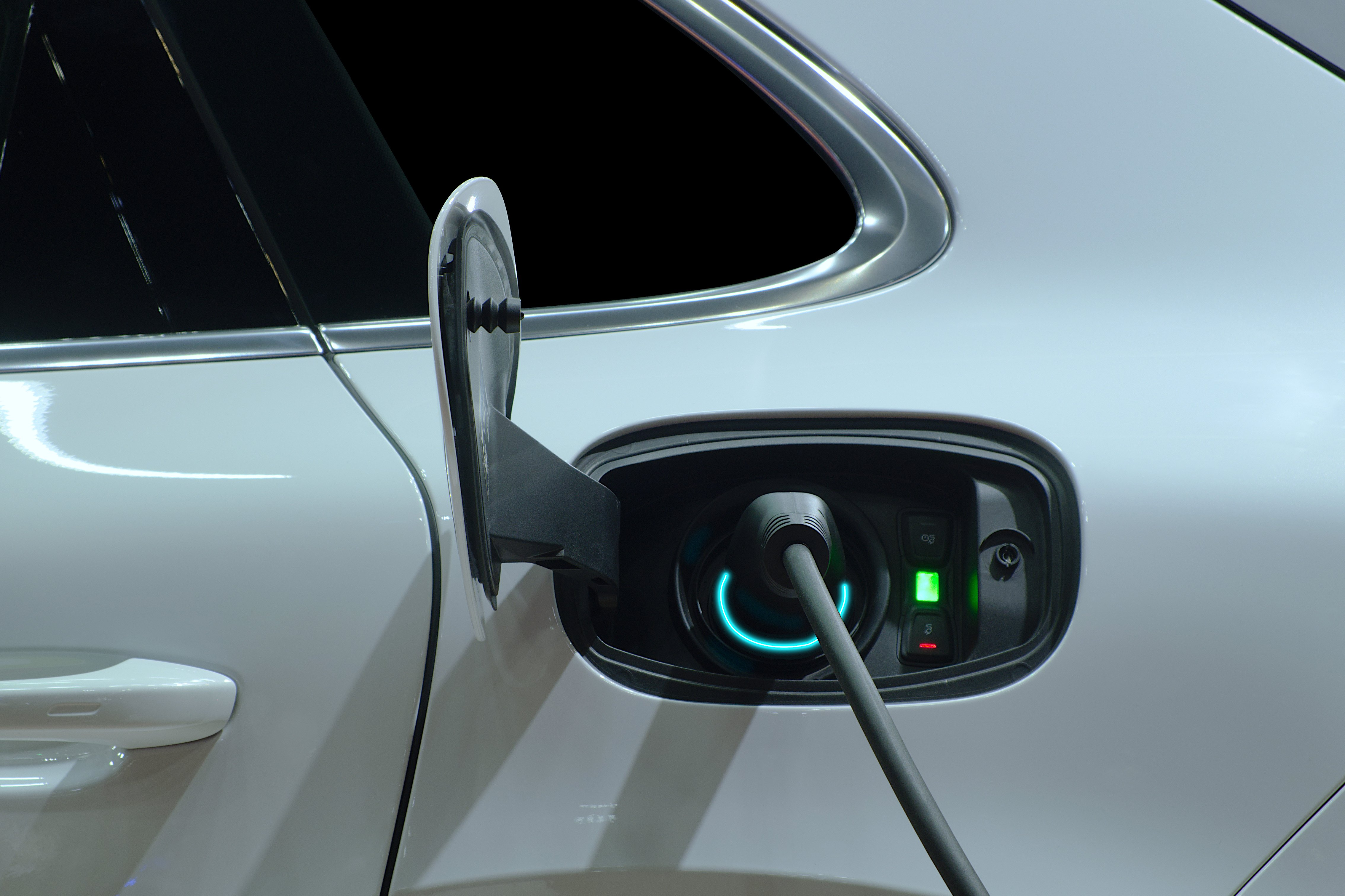 A close-up image of an electric car being charged.
